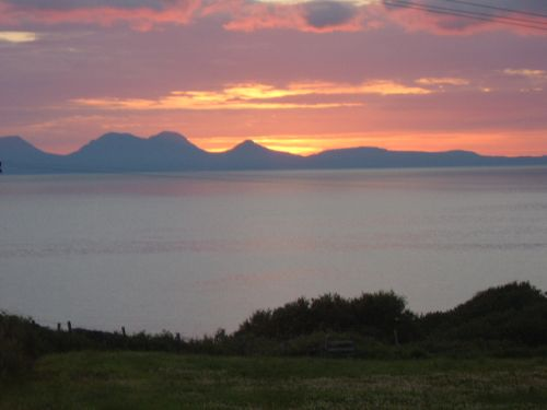 Sunset over Jura from the beach at Killegruer