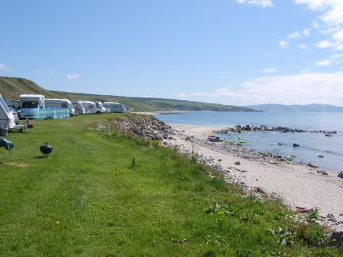 Tourers,motor homes etc overlook beach ,campfires allowed